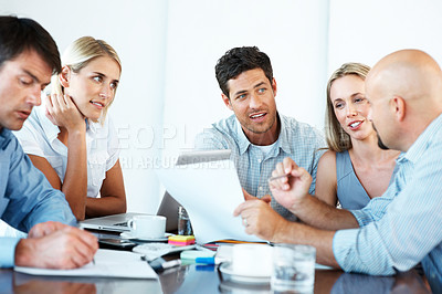 Buy stock photo Business team working on their business project together at office - Team work