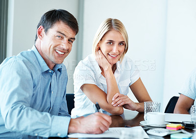 Buy stock photo Portrait of a happy business colleagues sitting together at office meeting