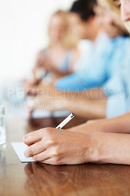 Buy stock photo Cropped image of businesspeople taking notes in a conference at office