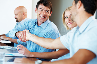 Buy stock photo Portrait of a happy mature businessman greeting a colleague at a meeting in office