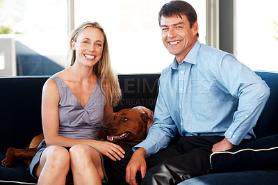 Buy stock photo Portrait of a pretty young couple sitting on sofa with their pet dog at home - Indoor.  Rhodesian ridgeback