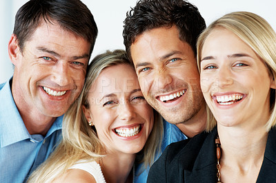 Buy stock photo Portrait of a successful business team smiling together at office