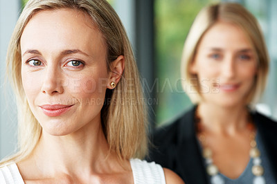 Buy stock photo Closeup portrait of a confident business woman with a colleague in background