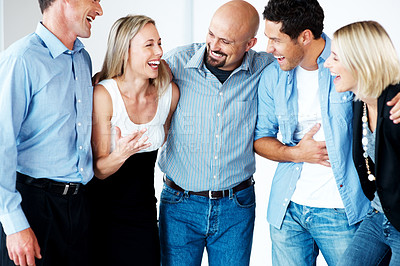 Buy stock photo Group of excited casual businesspeople standing together and celebrating their success
