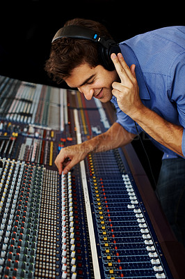 Buy stock photo Young man in sound studio working with sound mixer control desk