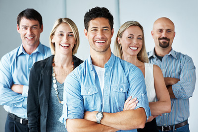 Buy stock photo Portrait of an attractive young business group standing together at office