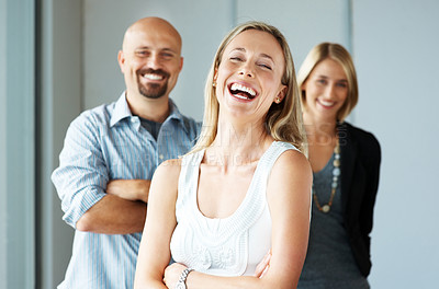 Buy stock photo Portrait of a excited business woman laughing with colleagues at the back