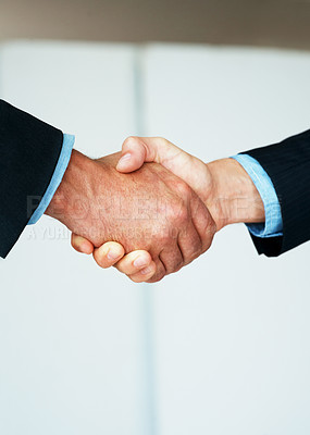 Buy stock photo Closeup of two business men shaking hands on a deal
