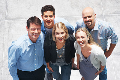 Buy stock photo Top view of happy group of business people standing together smiling and looking up