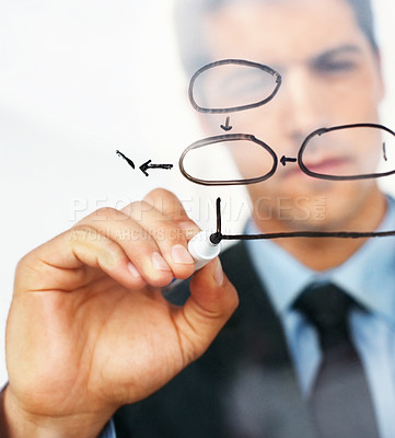 Buy stock photo Young businessman drawing a diagram representing his company's success