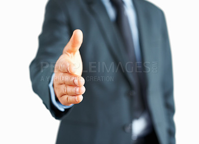 Buy stock photo Man in suit extending hand to shake