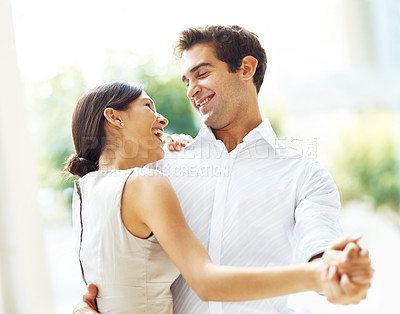 Buy stock photo Portrait of lovely young couple dancing together and smiling