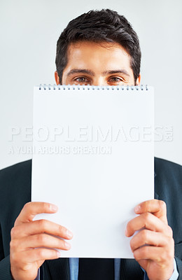 Buy stock photo View of businessman holding up notepad