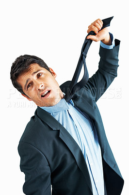 Buy stock photo Man in suit holding up tie to strangle himself