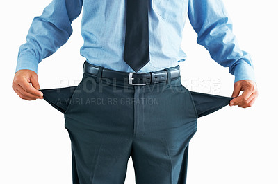 Buy stock photo Professional man revealing he has no money in his pockets
