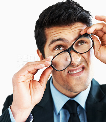 Buy stock photo Businessman holding glasses tilted while making a face, isolated on white - copyspace