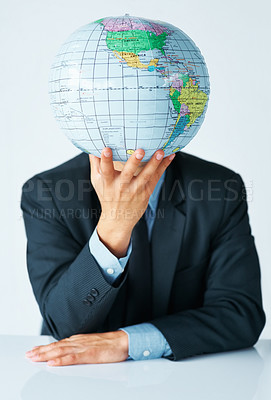 Buy stock photo View of businessman holding up globe