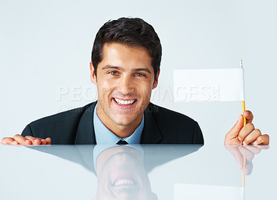Buy stock photo Businessman holding white flag while crouched down behind table