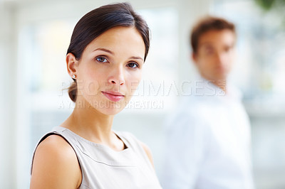 Buy stock photo Portrait of a confident yuong female  standing with a male in background