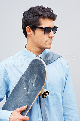 Buy stock photo Handsome business man in sunglasses holding skateboard