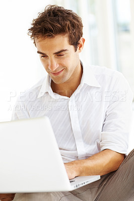 Buy stock photo Closeup of successful young male executive surfing internet on laptop