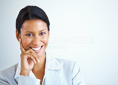 Buy stock photo View of female executive posing with hand on face