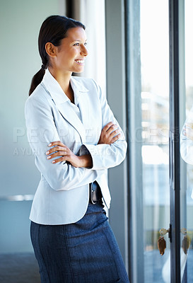 Buy stock photo Business woman with folded arms, looking out window