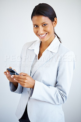 Buy stock photo Business woman dialing cell phone against white background