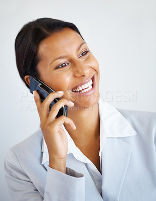Buy stock photo Business woman on cell phone, looking into distance