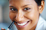 Attractive woman smiling while holding pen