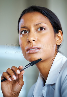 Buy stock photo View of pretty woman holding pen to chin while looking up