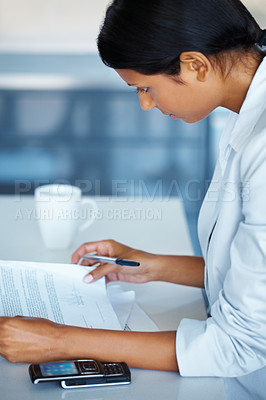 Buy stock photo Side view of business woman reviewing paperwork