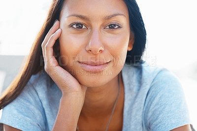 Buy stock photo Closeup of pretty woman resting her chin in hand