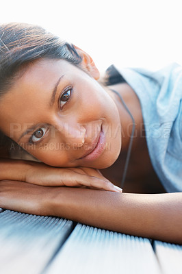 Buy stock photo Attractive woman resting her head on a table outdoors