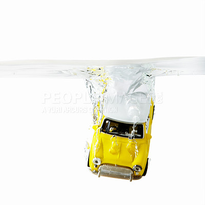 Buy stock photo View of Mini Cooper toy car dropped in water