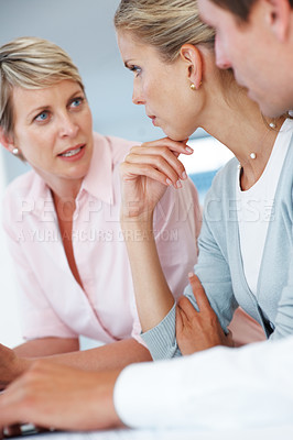 Buy stock photo Confident young business people in discission during a staff meeting at office