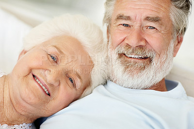 Buy stock photo Portrait of a loving senior couple relaxing at home