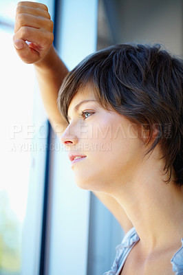 Buy stock photo Closeup of thoughtful business woman looking out through window