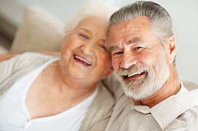 Buy stock photo Portrait of a happy senior couple spending time together at home