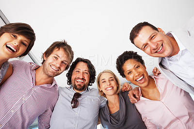Buy stock photo Low angle view of smiling business people standing in huddle