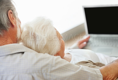 Buy stock photo Rearview of a senior couple working together on laptop