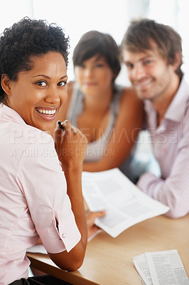 Buy stock photo Portrait of professional consultant with couple in background