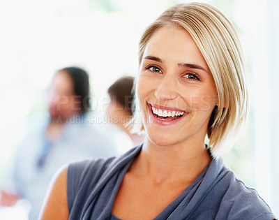 Buy stock photo Attractive woman with colleagues talking in background