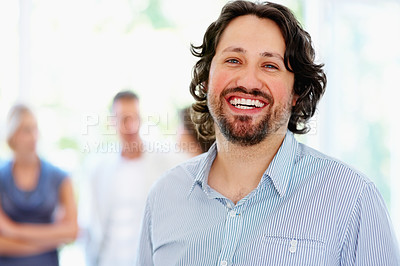 Buy stock photo Focus on man with people in background