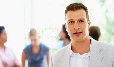 Buy stock photo Focus on man with colleagues in background