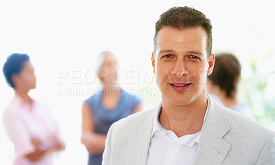 Buy stock photo View of man with colleagues in background