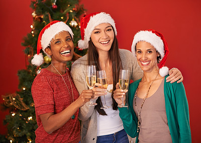 Buy stock photo Portrait of three friends toasting each other at Christmas time