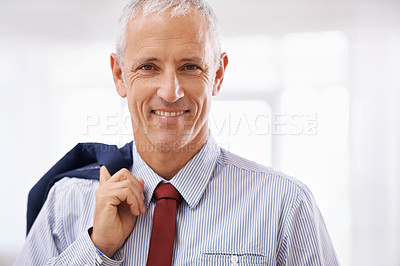 Buy stock photo Shot of a mature businessman ready to go home for the weekend
