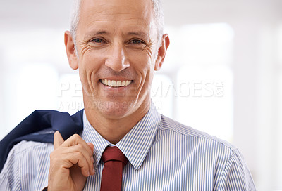 Buy stock photo Portrait of a mature businessman holding his jacket over his shoulder