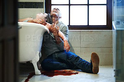Buy stock photo Shot of a distraught man embracing a woman with a slit wrist in a bathtub